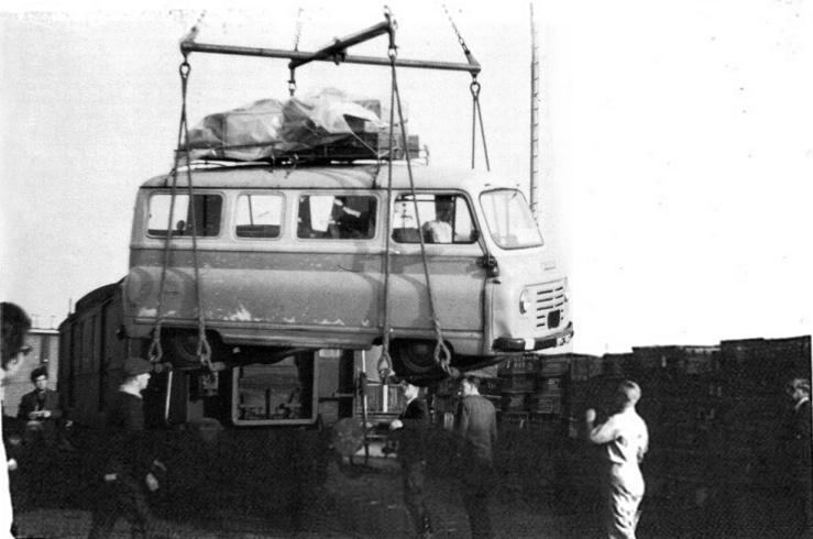 John Lennon looks on as their van is loaded onto the ferry
